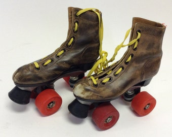 Small Vintage Distressed brown Leather Roller Skates 4/6
