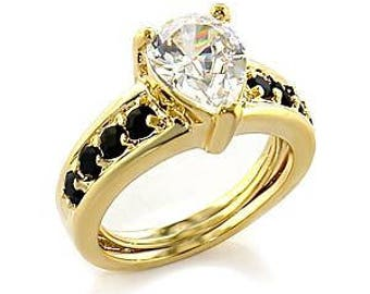 Ring - reflo381 - gold - plated set with black cz and a solitaire white cz