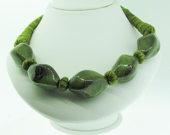 Chunky and unique threaded necklace with green stones.