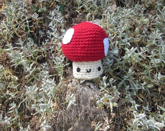 Red and white mushroom with incorporated, crochet blanket