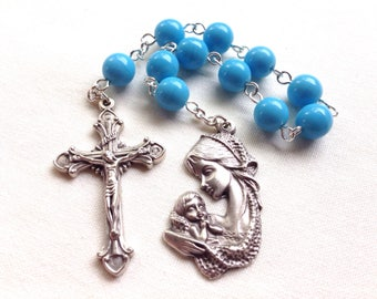 Blue Catholic pocket rosary with mother and child medal