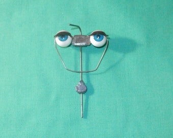 "vintage blue sleepy eyes/plastic 1.81""/0.58""/Germany"
