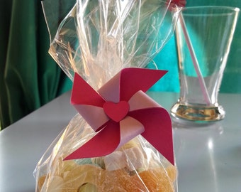 Candy bag decorated with pinwheel in handmade paper