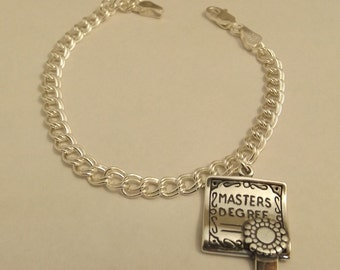 Sterling Silver Masters Degree Charm on a Sterling Silver Traditional Style Charm Bracelet - 1773