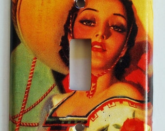 Mexican calendar girl  switch plate cover for a single switch.