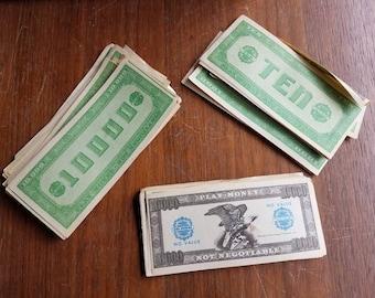 Play Phoney Dollar Bills from Ten to 1000 Wad of Cash