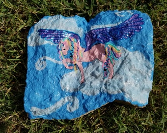 Large decorative painted garden stone with pegasus in the sky