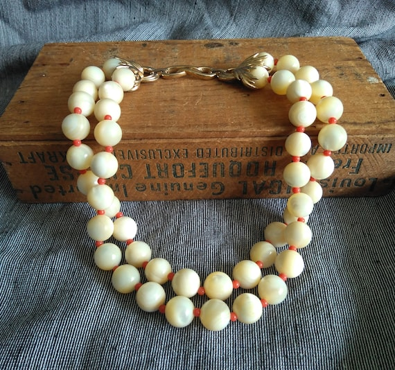Heavy vintage signed and numbered Boucher mother of pearl and coral bead double/two strand necklace, 1960s