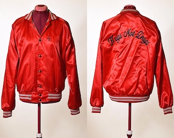 "Vintage 1970's "" Hugs Not Drugs"" embroidered one of a kind nylon bomber red and white stadium snap up oversized jacket size medium"
