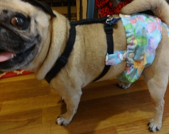Female Dog Diaper That Stays On! Attaches To Any Harness(Not Included) Diaper Opens In The Back So It Is Easy To Put On!