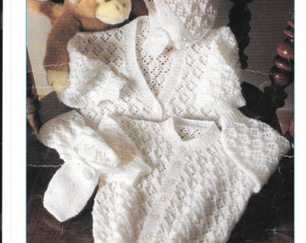 Pretty PDF knitting pattern for a babies V and round neck cardigan, hat and mittens - 3 ply wool. Sizes 16 - 22 inch/ 3 mths to 2 years