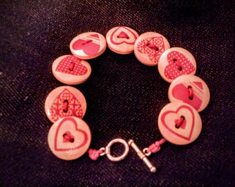 Heart printed button bracelet