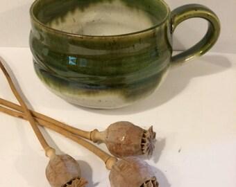 Large green stoneware mug.