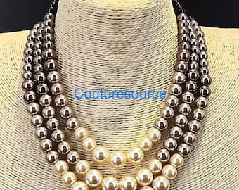Luxury ombre style pearl bib/choker necklace with extended chains.