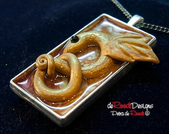 Golden Winged Snake Pendant