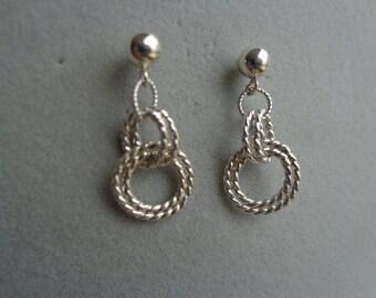Dangling twisted wire .925 silver earrings.