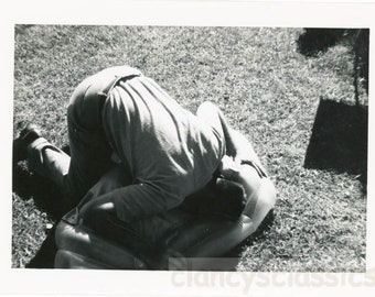 vintage photo 1950s Abstract Man Bends Over Head in Blow up Toy snapshot