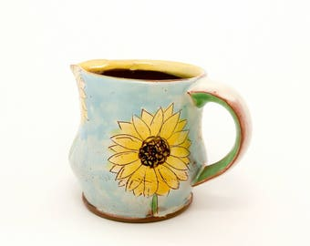 Blue sunflower themed Earthenware pitcher/creamer. Wheel thrown and altered, food safe, made by Kaitlyn Brennan/ Brennan pottery