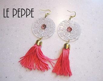 White/black filigree earrings and pink/black tassel