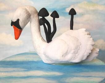 poetic swan with black mushroom display piece
