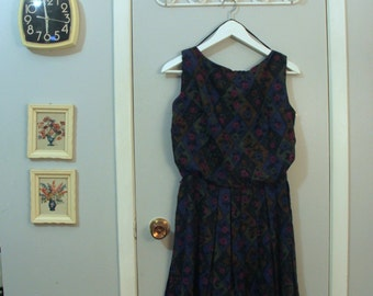 1960s sleeveless harlequin floral print dress