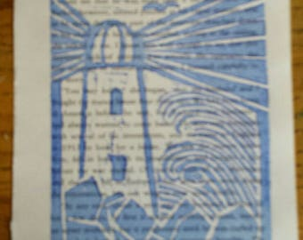 Lighthouse lino print on book page. Ready to be trimmed and framed. A6
