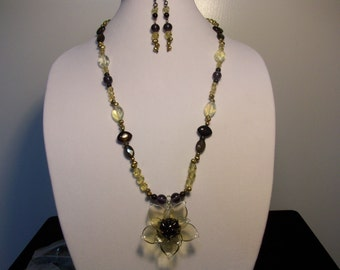 Black-eyed Susan pendant necklace and earring set.