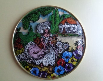 Vintage kitsch domed glass painted Crinoline lady wall plaque/picture.