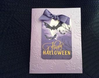 Happy Halloween card. Full moon bats