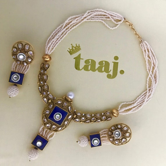 Haasa Gold and blue pearl mala necklace and earrings