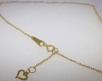 "Foot bracelet  heart shape at the end -14k yellow gold -length 10"" inches."