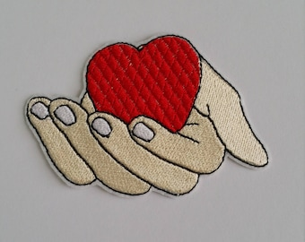 Hand holding heart iron on or sew on patch Heart iron on patch Heart patch Heart embroidery Heart embroidered patch Love patch Iron on heart