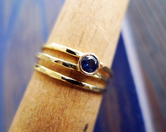 Claire Across The Universe. Asymmetrical Engagement Sapphire Ring. Hammered 14K Gold And Conflict Free Sapphire. Alternative Engagement Ring