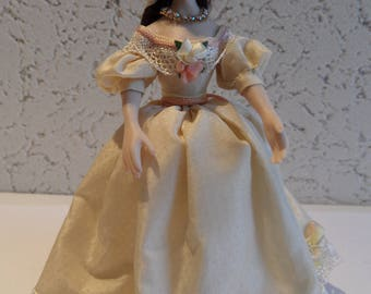 Standing Doll in creme dress