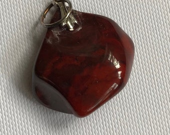 Deep brown-red petite pendant.