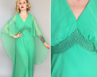 Small 1960s green maxi dress with cape