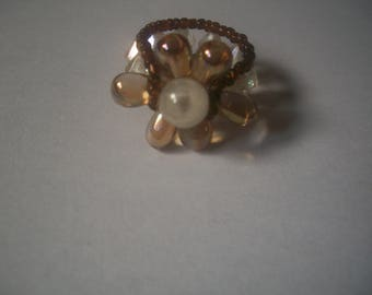 Ring made of clear and amber beads