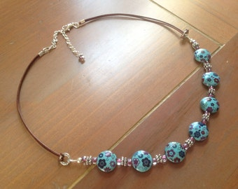 Turquoise Ceramic Beaded Necklace with Flowers Beads and Greek Leather with Swivel Clasp