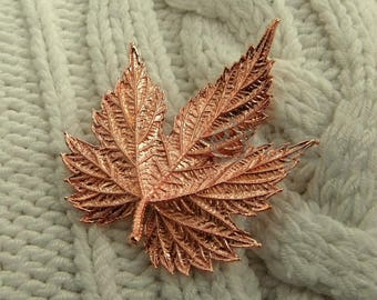 Shiny copper brooch