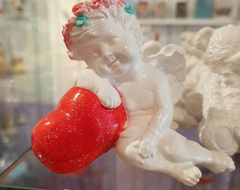 Cherub Angel on a statue, hand-made heart