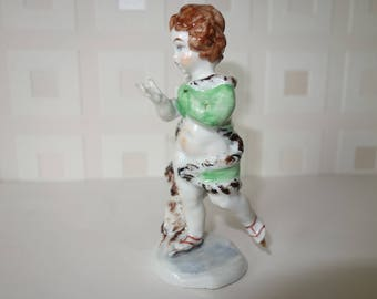 Ice skating Putti fine porcelain figurine with N under crown stamp