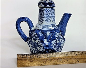 Chinoiserie Pitcher Asian Inspired Porcelain Blue and White Pitcher With Lid Bas Relief Around Body Tiny Chip on Spout