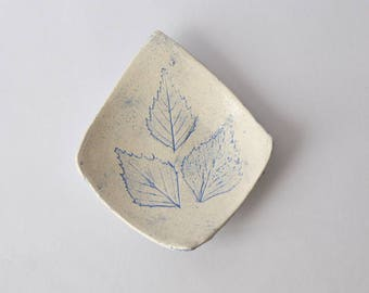 Ceramic Cup with imprints of leaves, pastel blue enamel, diamond-shaped