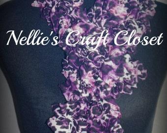 Purple, black and white ruffle scarf.