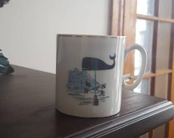 Baleine sur une girouette café ou une tasse de thé