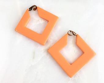 Vintage Orange Bakelite Clip On Earrings