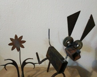 Upcycled metal dog and flower
