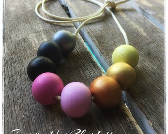 greys,pinks, metallic and yellow hand painted wooden bead necklace