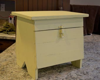 Handcrafted distressed storage stool