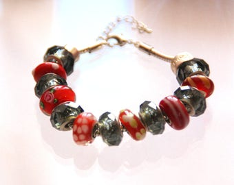 """The collection """"The whims of Millie"""" bracelet made of red beads"""